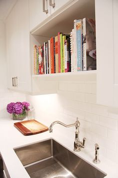 cookbook shelf. I was just thinking space above the sink is wasted when you don't have a window. What a perfect way to fix that!