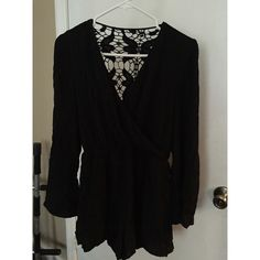 Black bell sleeve romper with lace back! This is a gorgeous black romper with bell sleeves and a beautiful, elegant lace back. It isn't tight fitting and looks great dressed up or down! Pair it with some colorful heels & jewelry to complete the look. Great condition. Francesca's Collections Pants Jumpsuits & Rompers
