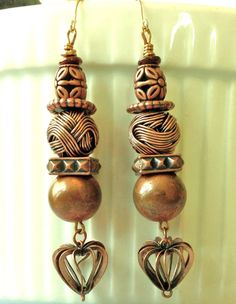 Brown wire antique copper colored beads extra long dangle earrings.  Please visit my ebay page to see all of my earrings for sale: www.ebay.com/...?:: Beaded Earrings, Drop Earrings, Earring Tutorial, Homemade Jewelry, How To Make Earrings, Copper Color, Necklaces, Bracelets, Wire Wrap