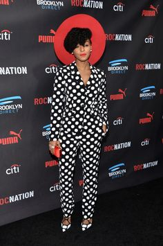 Pin for Later: Janelle Monáe's Signature Style Is Nothing to Mess With  Janelle matched her polka-dot suit to her killer pumps and finished her look off with fiery red accessories.
