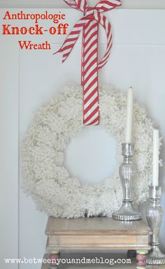 Love this pretty white yarn wreath. Looks soft and cozy :)