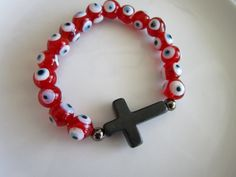 Red and white evil eye charm black side cross by LeeliaDesigns