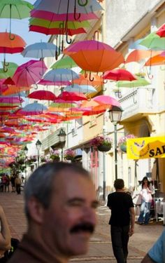 One city in Portugal gets creative when providing some shade to its downtown shoppers.