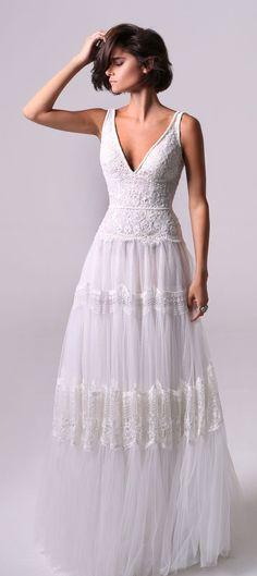 bohemian styled wedding gown multiple beaded lace and embroideries. Sleeveless wedding dress : Michal Medina #weddingdress #weddinggown #bridalgown #weddingdresses