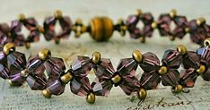 """DIAMOND CHAIN 11/0 seed beads Cousin """"Antique Bronze"""" (AJM61215018) 4mm bicones """"Amethyst"""" (#C12 - Beads One ) This is another one o..."""