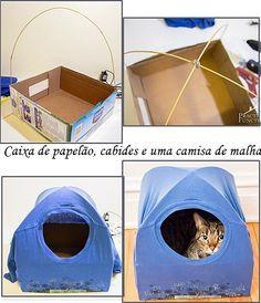 Uma casa para o gatinho com uma caixa de papelão, cabides e uma camisa de malha! E tem mais 11 ideias neste post. É só clicar!
