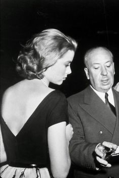 Grace Kelly and Alfred Hitchcock during the filming of Rear Window, 1954