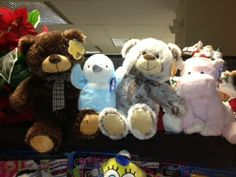 Happy stuffed animals waiting for the ride to their new home thanks to Toys for Tots.
