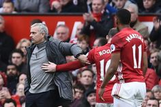 Manchester United's Portuguese manager Jose Mourinho gestures to Manchester United's English striker Wayne Rooney as he walks from the pitch, substituted during the English Premier League football match between Manchester United and Bournemouth at Old Trafford in Manchester, north west England, on March 4, 2017. / AFP PHOTO / Oli SCARFF / RESTRICTED TO EDITORIAL USE. No use with unauthorized audio, video, data, fixture lists, club/league logos or 'live' services. Online in-match use limited…