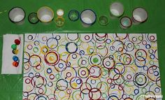 Materials large sheet of sturdy weight paper acrylic paints shallow dish or paper plate assortment cylindrical containers such as paper cups toilet paper roll, bottle caps, marker lids, round blocks, corks, plastic container. Pour paints into paper plates or shallow dish. Print away :-)