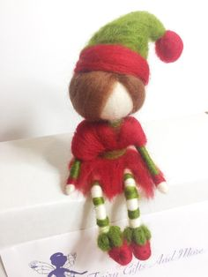 Needle Felted Christmas Elf! Be one of the first to own one of these adorable little Christmas Elves! Designed to sit with their legs dangling, these elves would make a lovely addition to your home. Elves measure approximately 18.5 cm from head to toe. ***Please note figurines sold