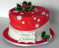 "Merry Christmas - The client wanted something ""not to Christmas-y"" but still ringing true to the holiday season. So we made holly, snowflakes and dragee snowballs against layered hills of snow on this fondant cake."