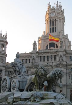 Cibeles Fountain – Madrid, Spain   Cybele (or Ceres) was a Roman goddess of fertility. The fountain depicts the goddess, sitting on a chariot pulled by two lions. It was built by Charles III and designed by Ventura Rodríguez between 1777 and 1782. The sculptures of goddess and chariot are by Francisco Gutiérrez and the work of lions by Roberto Michel. The building behind was originally the post office. Now it is the Madrid City Hall.