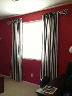 Sports bedroom with curtain rods made from Lacrosse sticks and material made to look like referee shirts. How cool!