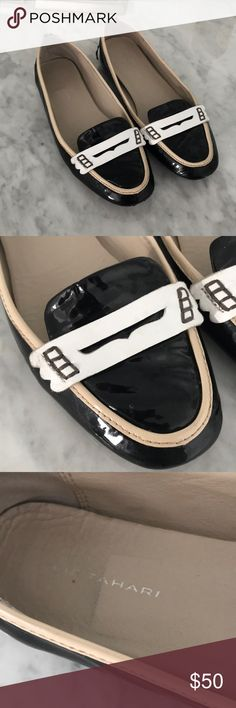 Ellie tahari shoes Ellie tahari shoes black and white.  Back is a little torn.  Otherwise great condition. Elie Tahari Shoes Flats & Loafers
