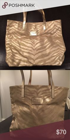 ⭐️New Michael Kors Tote⭐️ New MK Gold Tote! Great for the summer!! Beautiful Gold on Gold zebra (animal print). Gold handles and emblem. Brand new! Never used. Great Deal! KORS Michael Kors Bags Totes