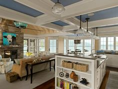 Love the dusty blue insets in this ceiling in a project by The Cushman Design Group