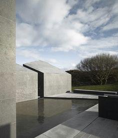 Flamed Granite cladding. Sculptural architecture