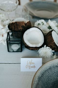 Summer Breeze Dinner Party with Coconuts and Coral #entertaining #tropicalweddingideas #coconuts #tablescape #outdoorparties
