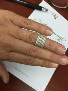Our marketing director often can be found trying on all the jewelry, instead of you know sending the thank you cards she's supposed to be sending to clients.  WE LOVE OUR CLIENTS AND OUR JEWELRY THAT MUCH!  lol. #Naladams, #Diamondeternitybands