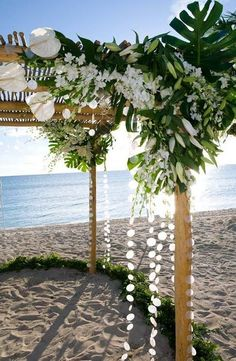 Great beachy wedding arbor with tons of lilies, monstera foliage, stock, and then some capiz shell streamers. Very nice! Beach Wedding Centerpieces, Beach Wedding Reception, Beach Wedding Flowers, Wedding Flower Arrangements, Floral Wedding, Wedding Ceremony, Wedding Decorations, Luau Decorations, Palm Wedding