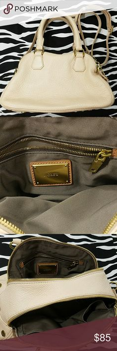 J. Crew Biennial Leather Satchel Beautifully crafted with gold hardware and pebbled leather. It has two compartments one has slots for your phone and accessories the other side has a zippered pocket. Shows just the slightest signs of wear but nothing that stands out. J. Crew Bags Satchels