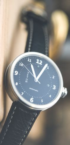 Xetum Stinson with black dial and black leather strap. Designed in California, made in Switzerland.