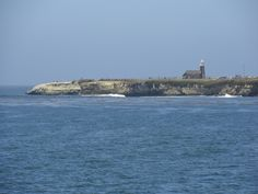 looking over at Steamer Lane.... waves along the coastline.... good surf spot... bring ur camera- these folks are good!