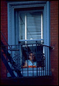 E. 7th Street, Woman at the window 1979 by Michael Sean Edwards