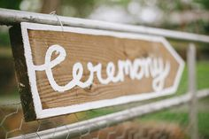White, painted trim around the ceremony arrow sign.
