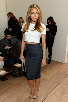 mirnah:  At the Michael Kors show, Naya Rivera looked really sophisticated in a textured ivory crop top and denim pencil skirt. She complimented her minimal, clean look with daring accessories, starting with python ankle-strap heels for a touch of edginess and a metallic clutch for a necessary dose of shine. While you may not be sitting front-row at the Michael Kors show, you can try a hand at re-creating Rivera's look with my picks below!   Celebs, fashion and models. X