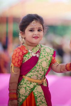 7d9b3fecb0e1 Baby girl in traditional maharashtrian nine yard saree
