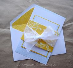 Improving cheap DIY wedding invites from a kit with added contrast craft paper for a more individual style.  Could save a lot of money if everything is bought on sale and with coupons.  I am seriously considering this crafty option...
