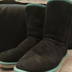 Ugg classic short pinstripe boot These boots cannot be purchased any longer. Navy with turquoise detail around top and edge.  Boots show minor wear but are in amazing condition.  Can provide additional pictures to serious buyers if needed.  Message me with any questions UGG Shoes