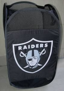 """OAKLAND RAIDERS PORTABLE POP-UP LAUNDRY HAMPER! by Forever Collectibles. $10.25. Top Quality, Manufactured by Forever Collectibles. Officially licensed by the NFL. Officially licensed by the Oakland Raiders. Lightweight, Durable Nylon. Pops Up Quickly. Folds in Seconds. Perfect for the Dorm or Kid's Room. Terrific design features official team logo and colors. Folds flat to about 8 in diameter; quickly pops up to a 24"""" tall hamper. Holds about 1-2 loads of laundry. Top ca..."""