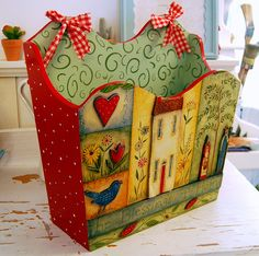 I like the colours used for this whimsical folk art piece. via Flickr.