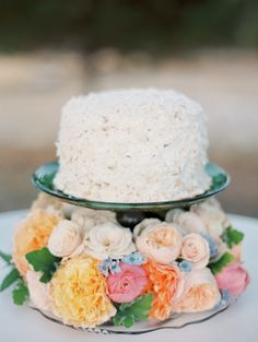 Colorful floral-accented cake: http://www.stylemepretty.com/montana-weddings/bitterroot-valley/2016/02/09/victorian-inspired-montana-bridal-session/ | Photography: Rebecca Hollis - http://rebeccahollis.com/