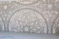Stenciled the Charlotte Allover stencil pattern on a bookshelf.  http://www.cuttingedgestencils.com/charlotte-allover-stencil-pattern.html