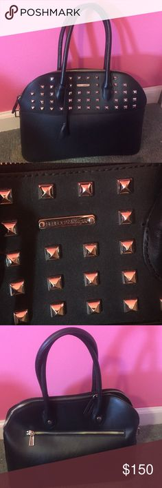 Rebecca Minkoff Large Studded Bag Perfect condition black studded Rebecca Minkoff Bag. Perfect size to carry everything you need without being overly big or bulk. Beautiful bag! Rebecca Minkoff Bags