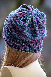 """This fun, unisex hat works up quickly! To make it, you'll need roughly 175 - 225 yards of dk weight yarn, as well as one 16"""" circular needle in size US 5, one 16"""" circular in size US 6, and one set of double pointed needles, also in size US 6"""