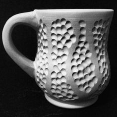 Carved pattern on a mug. Cone six oxidation. Made out of b-mix.  Soon to be bisque fired  www.facebook.com/amandasullivanpottery