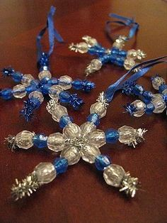 Craft idea for Charlies holiday party at school- silver pipe cleaners with clear and blue beads