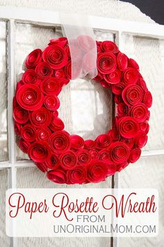 This beautiful DIY Paper Rosette #wreath project includes a free cut file for #Silhouette CAMEO or Portrait users, but it also can be made easily by hand! It would be gorgeous to hang on your front door in the summer or to hang from the inside as a romantic home decor accent for #Valentine's Day.