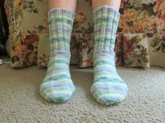 Here is a wonderful pair of hand knit adult size socks. The color is called Watercolor. Heel to toe is approx. 9 1/2 in. and the ribbing on the top (top to ankle) is approx. 6 1/2 in. These socks are made of 100% acrylic yarn and can be machine washed and dried.