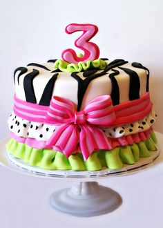 pink and green zebra birthday cake with ruffles and bows