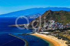 Qdiz Stock Photos | Aerial view to Santa Cruz city and beach,  #aerial #Atlantic #background #beach #blue #breakwater #Canary #City #coast #coastline #Cruz #island #landscape #LasTeresitas #mountain #nature #ocean #playa #rock #Santa #sea #shore #sky #Spain #spring #summer #Teide #Tenerife #view #volcano #water #yellow