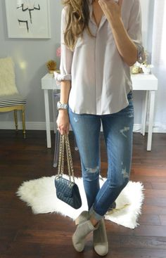 Low rise boots, ribbed jeans and blouse and bag. Fall fashion trends 2015/2016.: