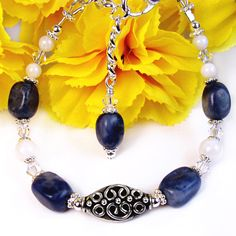Blue Sodalite and White Shell Beaded Adjustable Bracelet, with Bali Style Center Bead and Swarovski Crystals by #PrettyGonzo - #Handmade #Jewelry (Please note: This bracelet has SOLD.)
