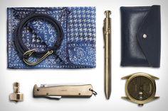 Isaia Pocket Square ($95). Best Made Mercator Knife ($72). Karas Kustoms The Bolt Pen ($75). Hender Scheme Card Case ($158). 1964 Rolex Day-Date Watch ($5,500). Port Union Fish Hook Bracelet ($14). J. L. Lawson & Co. Mini EDC Top ($38)....