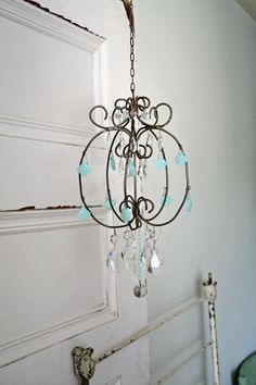 diy chandelier from a hanging plant basket pinterest plant rh pinterest com Chandelier Wiring Parts Wiring Schematic On Chandelier